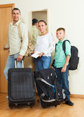 Happy family travelers going on holiday — Stock Photo