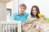 Couple near oil heater — Stock Photo