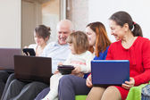 Family of three generations with laptops — Stock Photo