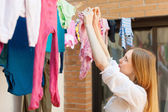Girl drying clothes after laundry — Stock Photo