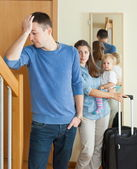 Woman with baby leaving home — Stock Photo