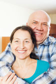 Happy elderly man with smiling girlfriend — Stock Photo