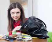 Girl looking for something in her purse — Stock Photo