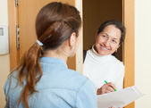Woman questionnaire for mature social worker — Stock Photo