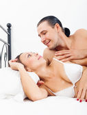 Loving middle-aged couple awaking together — Stock Photo