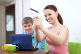 Couple doing shopping in internet with credit card — Stock Photo