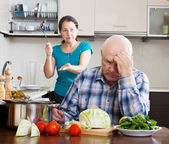 Family quarrel. Mature woman having conflict with husband — Stock Photo