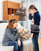 Mother and father scolding son at living room — Stock Photo