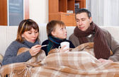 Parents with teenage son are ill together — Stock Photo