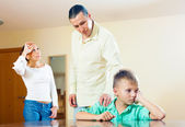 Parents scolding son in home. — Stock Photo