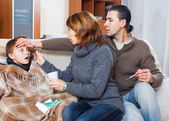 Parents and son with thermometer — Stock Photo
