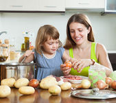 Happy mother with child cooking soup — Stock Photo
