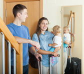 Happy family with suitcases — Stock Photo
