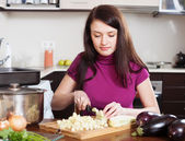 Housewife cutting the eggplant — Stock Photo
