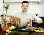 Smiling guy cooking — Stock Photo