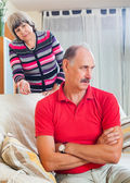 Tired mature man listening to angry wife — Stock Photo