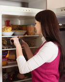 Woman looking for something in fridge — Stock Photo