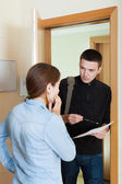 Collector trying to get the arrears from woman — Stock Photo