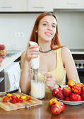Woman cooking dairy beverages — Stock Photo