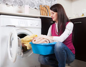 Brunette woman doing laundry — Stock Photo