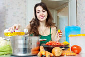 Young housewife cook with oil — Stock Photo