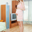 Pregnancy woman weighing herself — Stock Photo #46908379