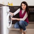 Brunette woman cleaning washing machine — Stock Photo #46908479
