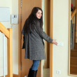Woman in coat  leaving  home — Stock Photo #46908597