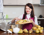 Brunette woman cooking pear jam   — Stock Photo