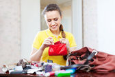 inconsiderate woman found  thing in purse — Stock Photo