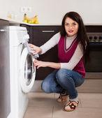 Brunette woman cleaning washing machine   — 图库照片