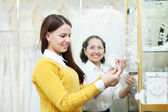 woman helps the girl in choosing bridal accessories   — Stock Photo