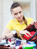 Inconsiderate woman  searching something in handbag — Stock Photo