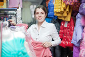 female buyer at clothing store — Stock Photo