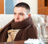 Ill sad man in warm scarf — Stock Photo