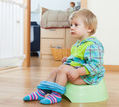 Baby  sitting on green potty — Photo