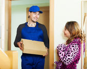 Courier brought package to woman — Stock Photo