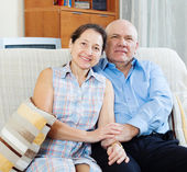 Mature couple together on sofa — Stock Photo