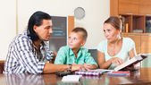 Family doing homework in home — Stock Photo