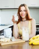 Happy girl drinking milk shake  — Stock Photo