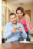 couple looking new digital camera — Stock Photo