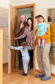 Family coming to grandmother  home — Stock Photo