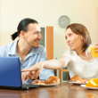 Couple looking e-mail in laptop during breakfast — Stock Photo #46910223