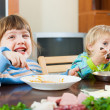 Happy children eating food — Stock Photo