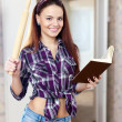 Pretty  housewife reads cookbook — Stock Photo #46910413