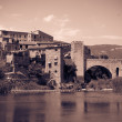 Retro photo of medieval fortifications and bridge — Stock Photo #46910657