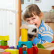 Happy 3 years child playing with kitten — Stock Photo #46910815