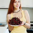 Housewife holding  plate with cherry — Stock Photo #46911289