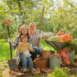Happy parents and child with   vegetables  — Stock Photo #46911671