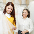 Bride chooses bridal veil at shop of wedding — Stock Photo #46912677